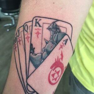 Tatuaje de El Alquimista en color hecho en el brazo